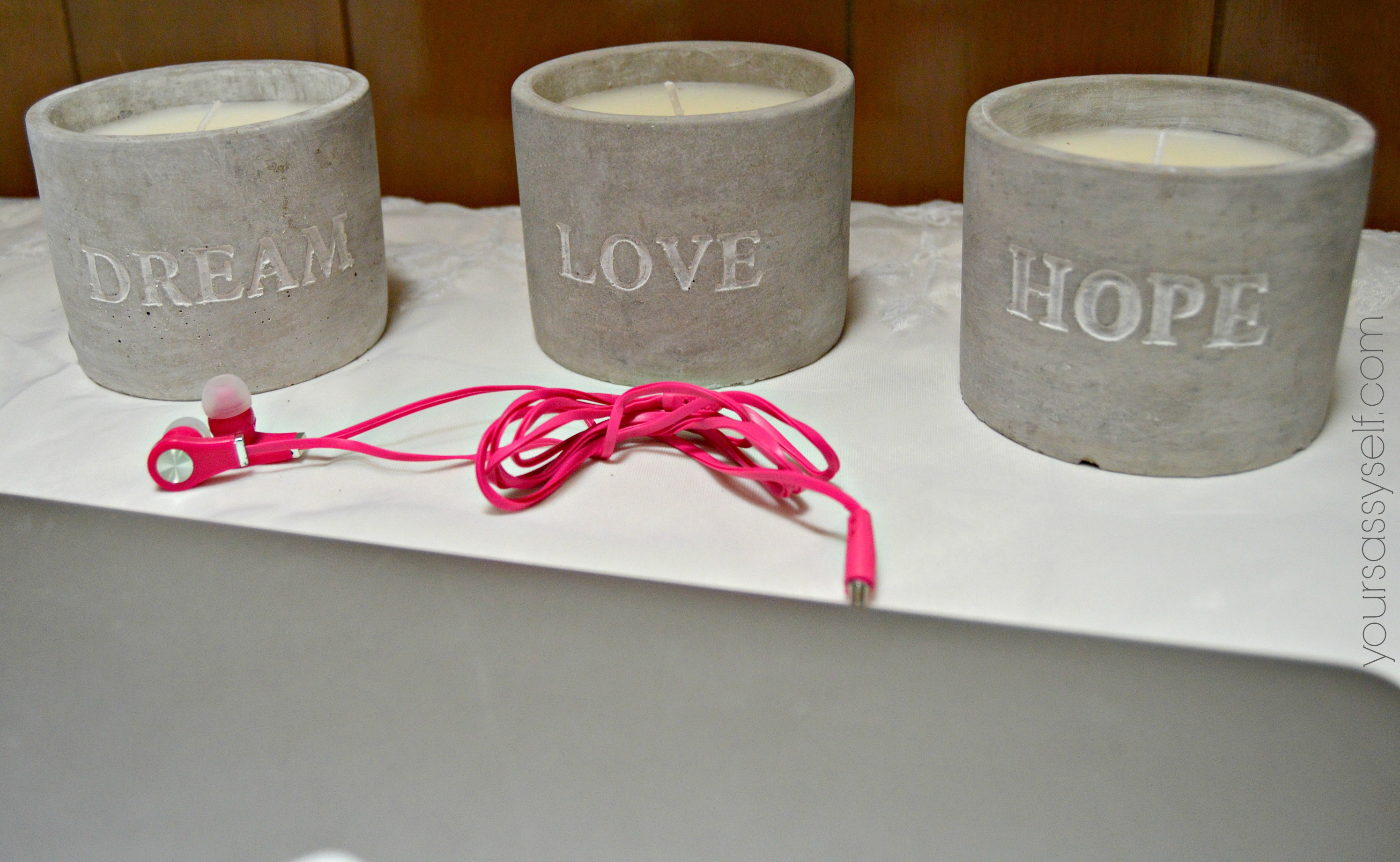 Hot Pink Earbuds in front of Dream, Love, Hope Candles - yoursassyself.com