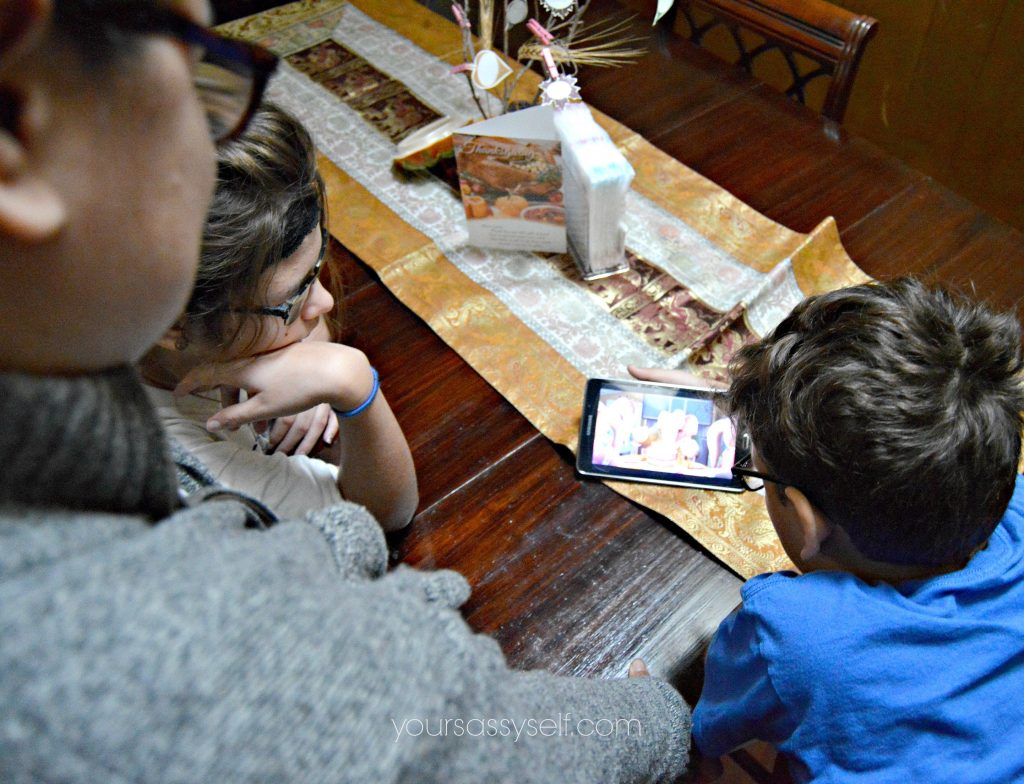 family-watching-content-on-portable-device-yoursassyself-com