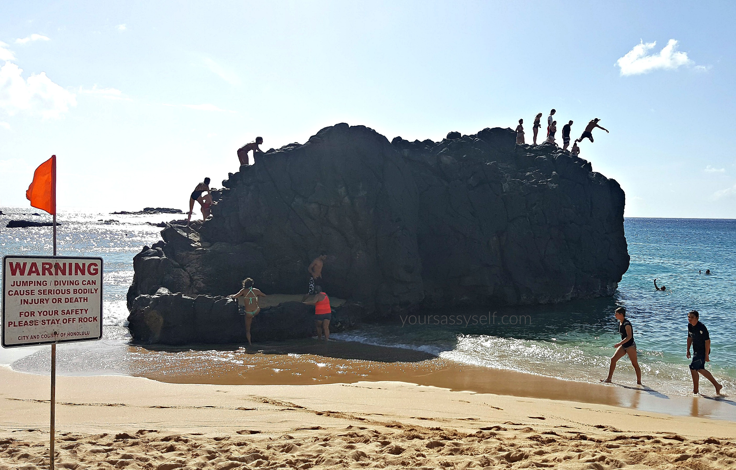 People Lined Up to Jump of Waimea Bay Rock - yoursassyself.com