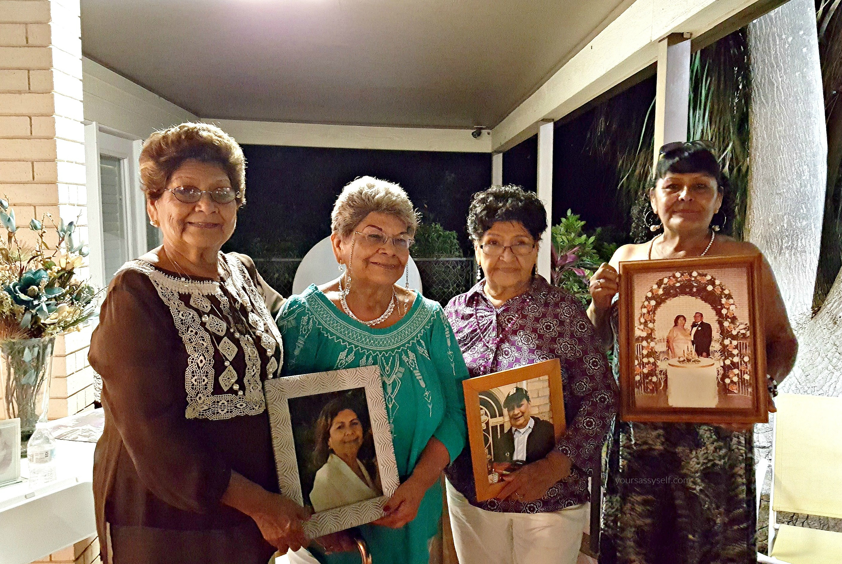 Sanchez Family holding Pics of Deceased Loved Ones - yoursassyself.com