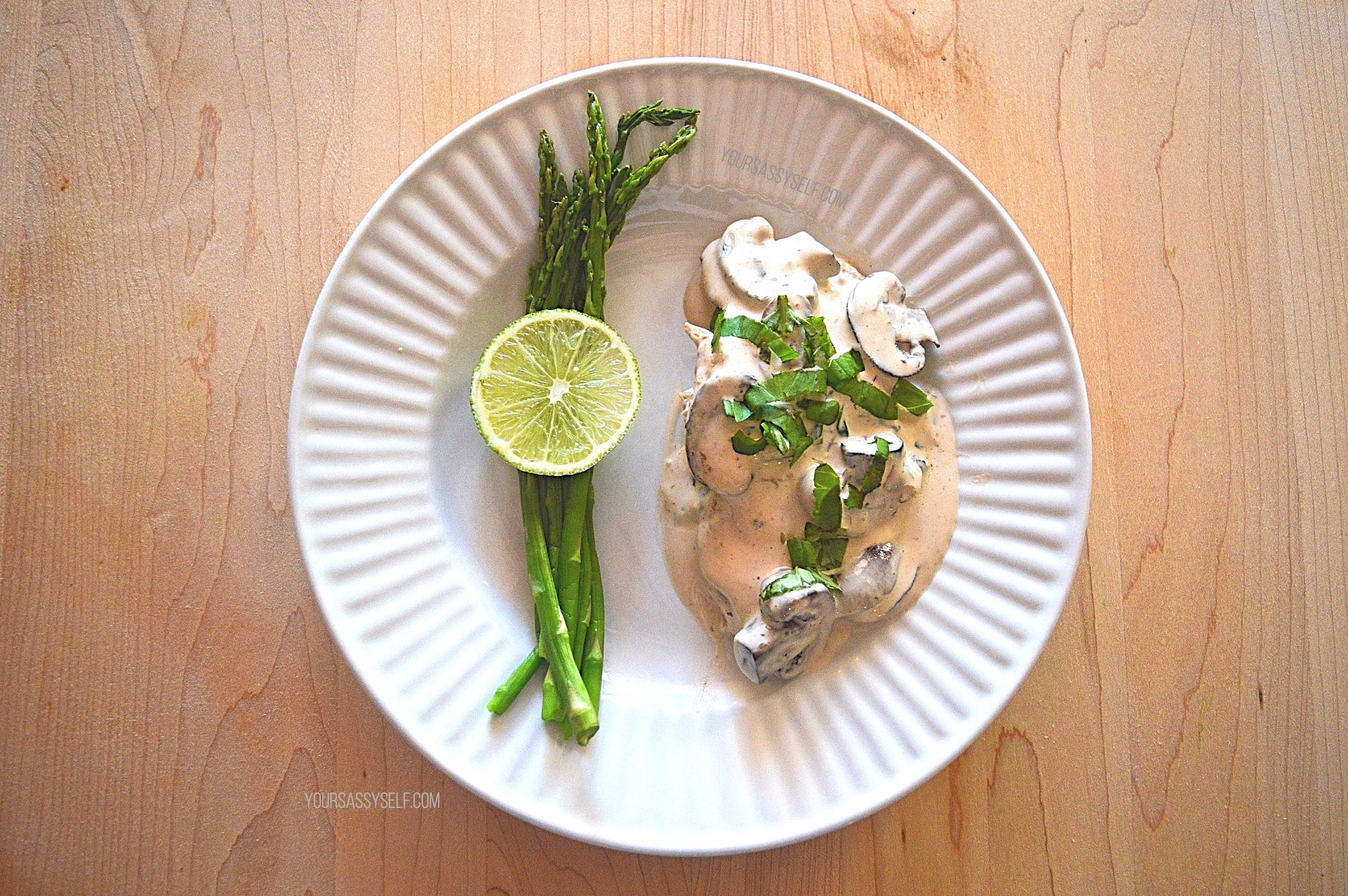 Plated Smothered Chicken and Asparagus - yoursassyself.com