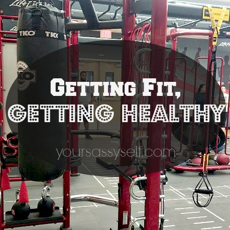 Getting Fit, Getting Healthy with TRX maching in background - yoursassyself.com