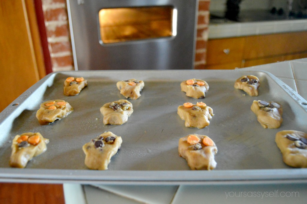 Skull shaped chocolate chip cookies on cookie sheet - yoursassyself.com