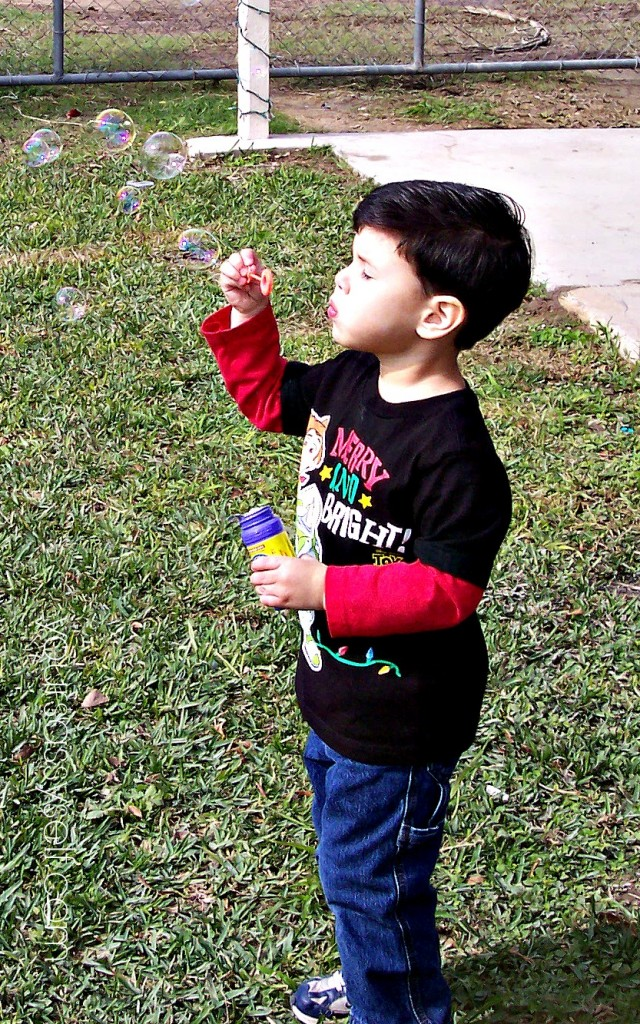 boy blowing bubbles - yoursassyself.com