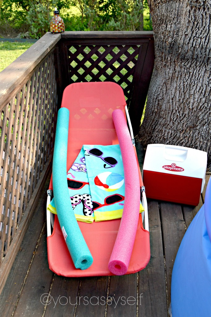 Lounge chair, beach towel, cooler - yoursassyself.com