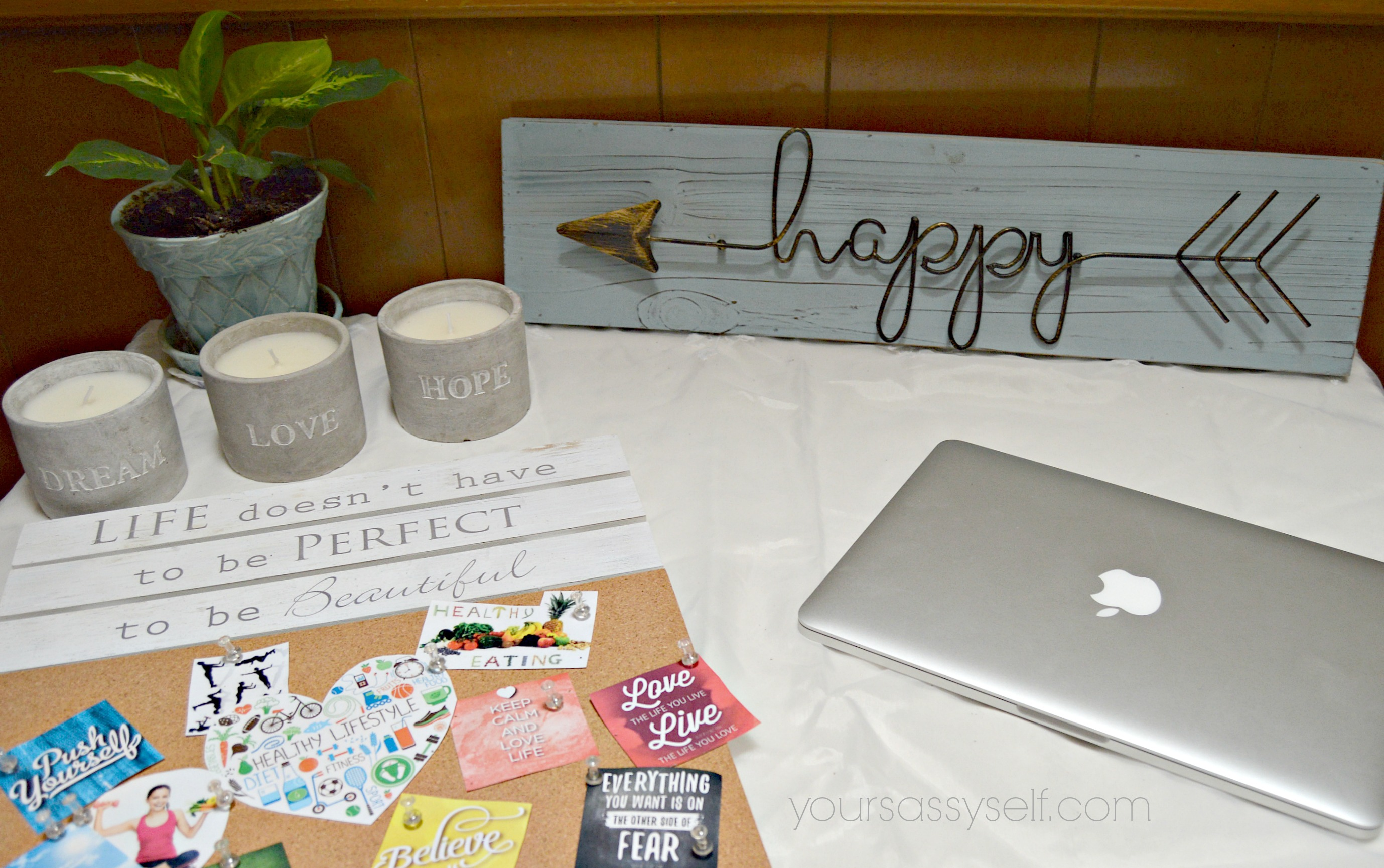 Desk with laptop and motivating decor - yoursassyself.com