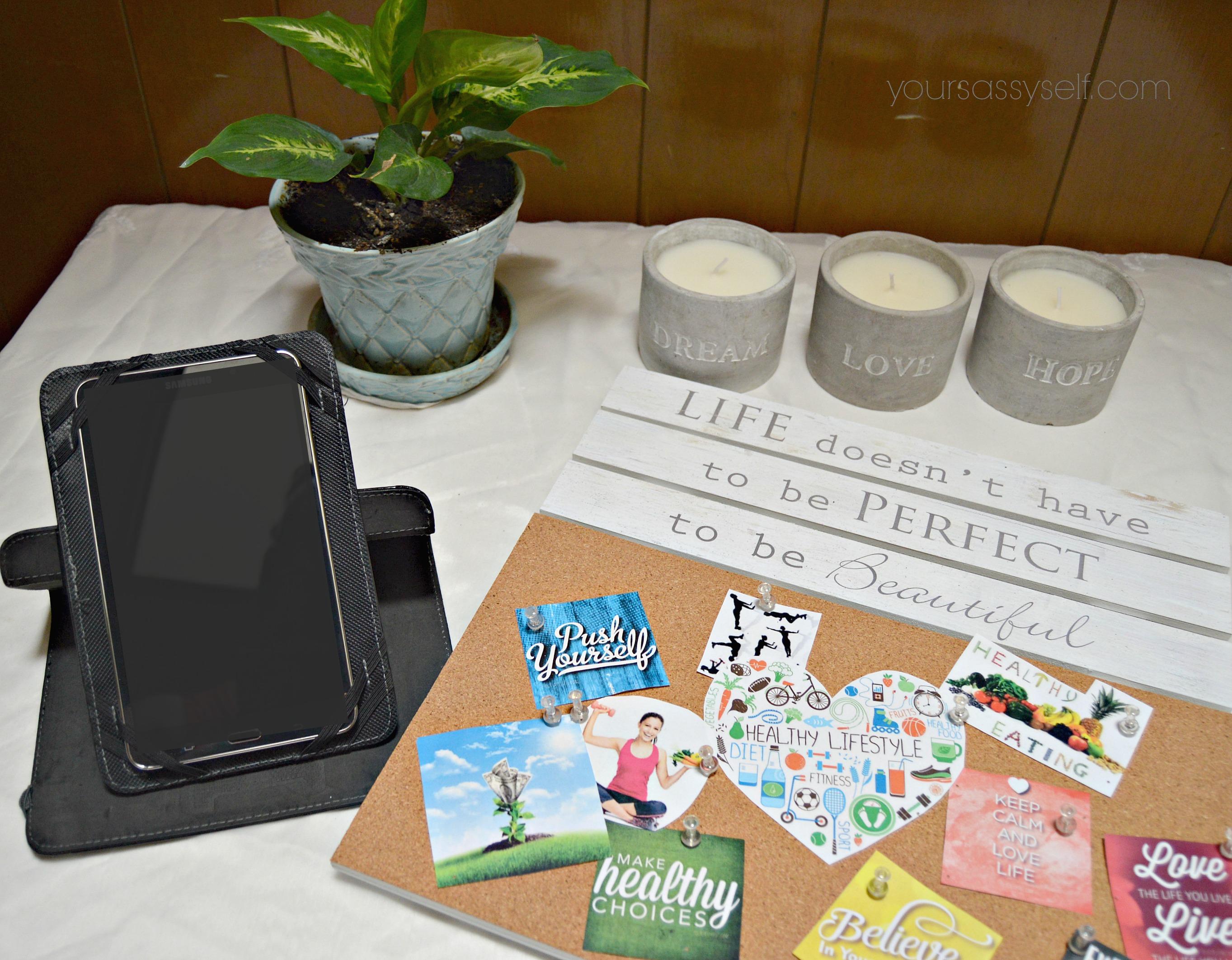 Tablet, plant, candles, vision board wall hanging - yoursassyself.com