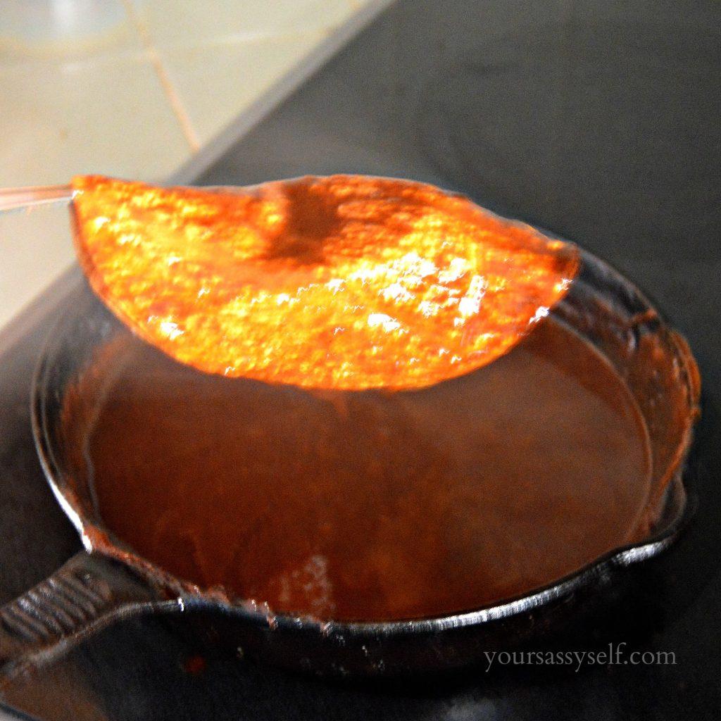 Dipping Corn Tortillas in Mole for Enmoladas - yoursassyself.com