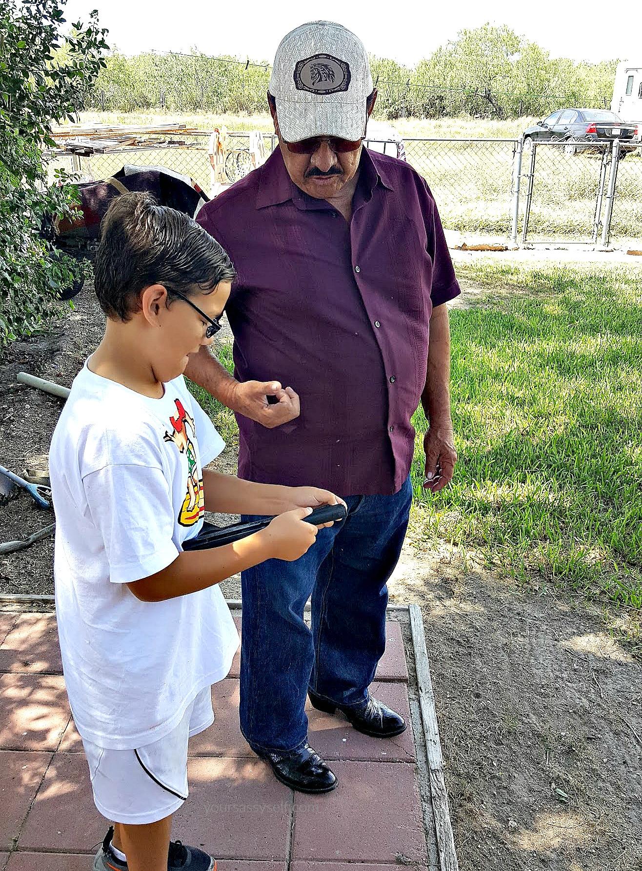 Grandpa teaching Grandson stuff - yoursassyself.com